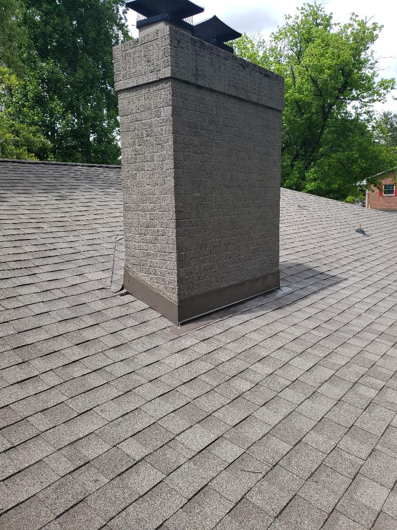 Powell, TN - A big comfortable family home needed a chimney leak repaired. IKO Weathered Wood shingles, GAF StormGuard leak barrier, decking and counter flashing were installed to repair the leaking chimney. Mobley Brothers Roofing and Renovation gives free estimates.