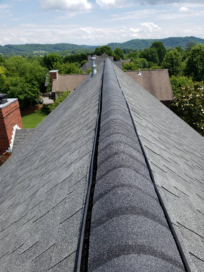 Powell, TN - We provided a free estimate for a roof repair. The roof was damaged and we installed a GAF Cobra Ridge Vent, and GAF Weathered Wood shingles. Mobley Brothers Roofing and Renovation is a GAF Master Elite Certified Contractor.