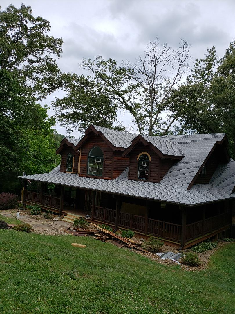 Jefferson City, TN - A beautiful log homes roof needed to be replaced. Mobley Brothers Roofing and Renovation installed a new roofing system. We removed the old damaged shingles and installed GAF Storm Guard Leak Barrier and GAF Timberline HD Birchwood shingles. Call us for all your roofing needs.
