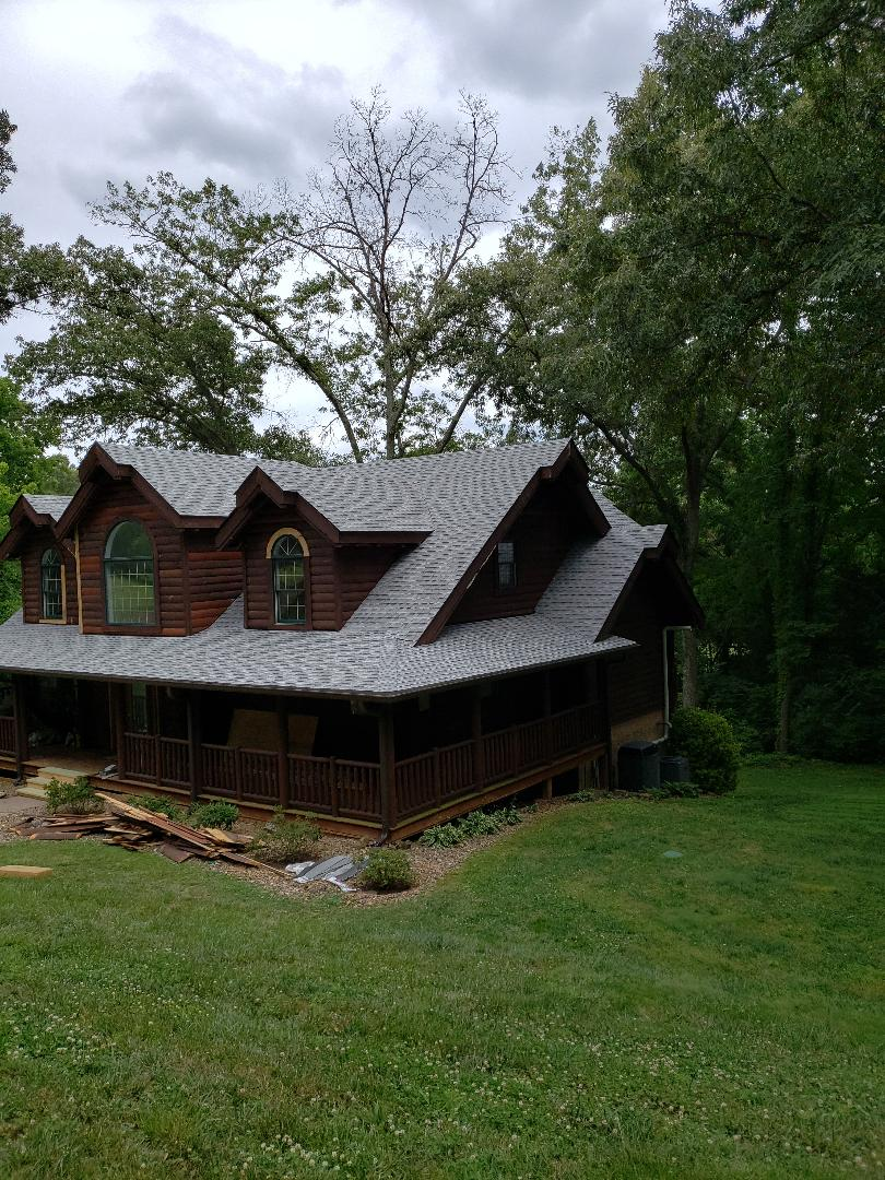 Jefferson City, TN - Mobley Brothers Roofing and Renovation installed a new roof. We removed the old roofing shingles and installed GAF Storm Guard Leak Barrier and GAF Timberline HD Birchwood shingles on this gorgeous log home.