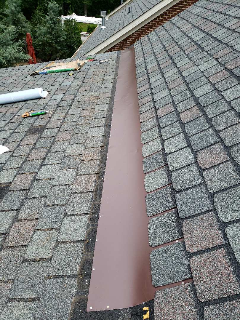 Knoxville, TN - A home had a significant leak in the transition of the roof. Mobley Brothers Roofing and Renovation installed flashing, and CertainTeed Highland Slate asphalt shingles in the New England Slate color. We repaired the leaking roof on this beautiful brick home.