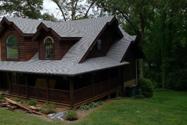 Jefferson City, TN - A damaged roof on a custom log home needed to be replaced and Mobley Brothers Roofing and Renovation installed a new GAF roofing system. GAF Timberline HD Birchwood shingles and GAF StormGuard leak barrier were installed.