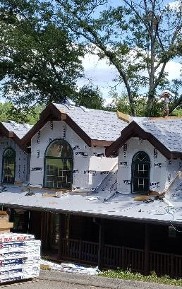 Jefferson City, TN - Mobley Brothers Roofing installed GAF StormGuard Leak Barrier and GAF Timberline HD Birchwood shingles on a custom log cabin. The old damaged shingles were removed and a new GAF roofing system was installed.