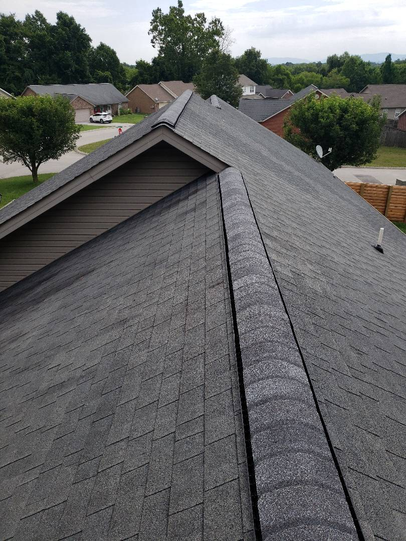 Maryville, TN - The ridge cap on this home was damaged in a storm and we repaired the roof.  Now the homeowner does not have to worry about the leak in their homes roof.
