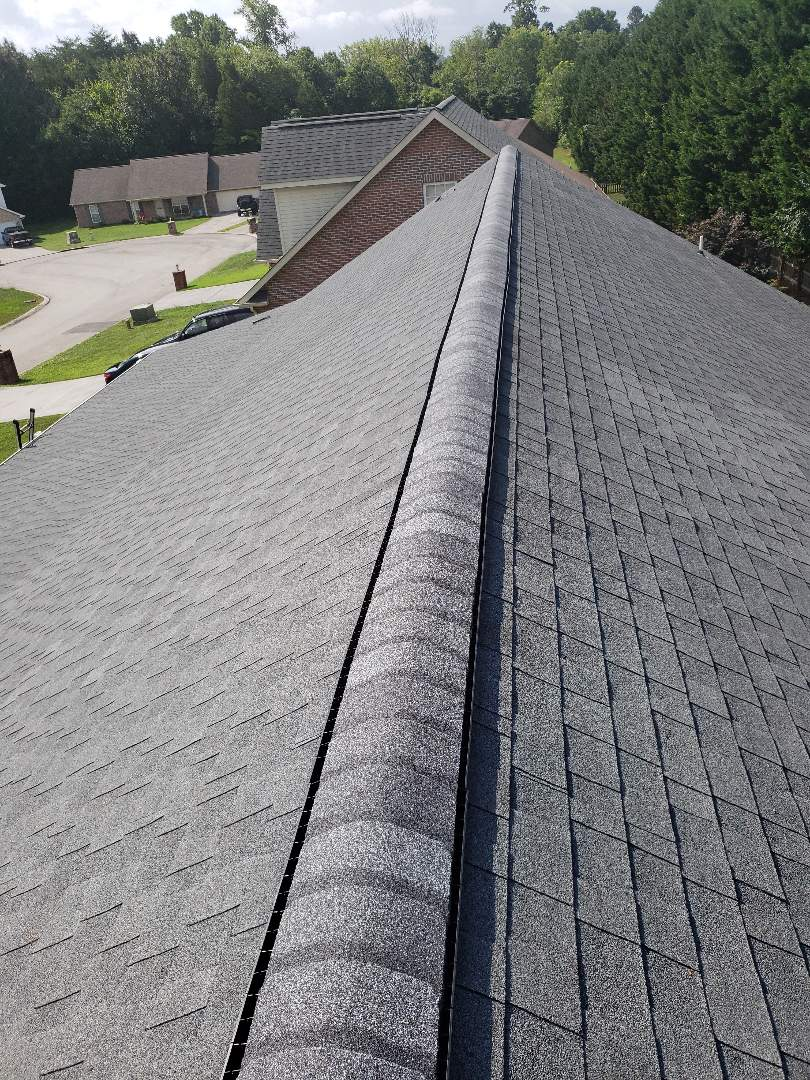 Maryville, TN -  Mobley Brothers Roofing and Renovation repaired the ridge cap on this home that was damaged in a storm.