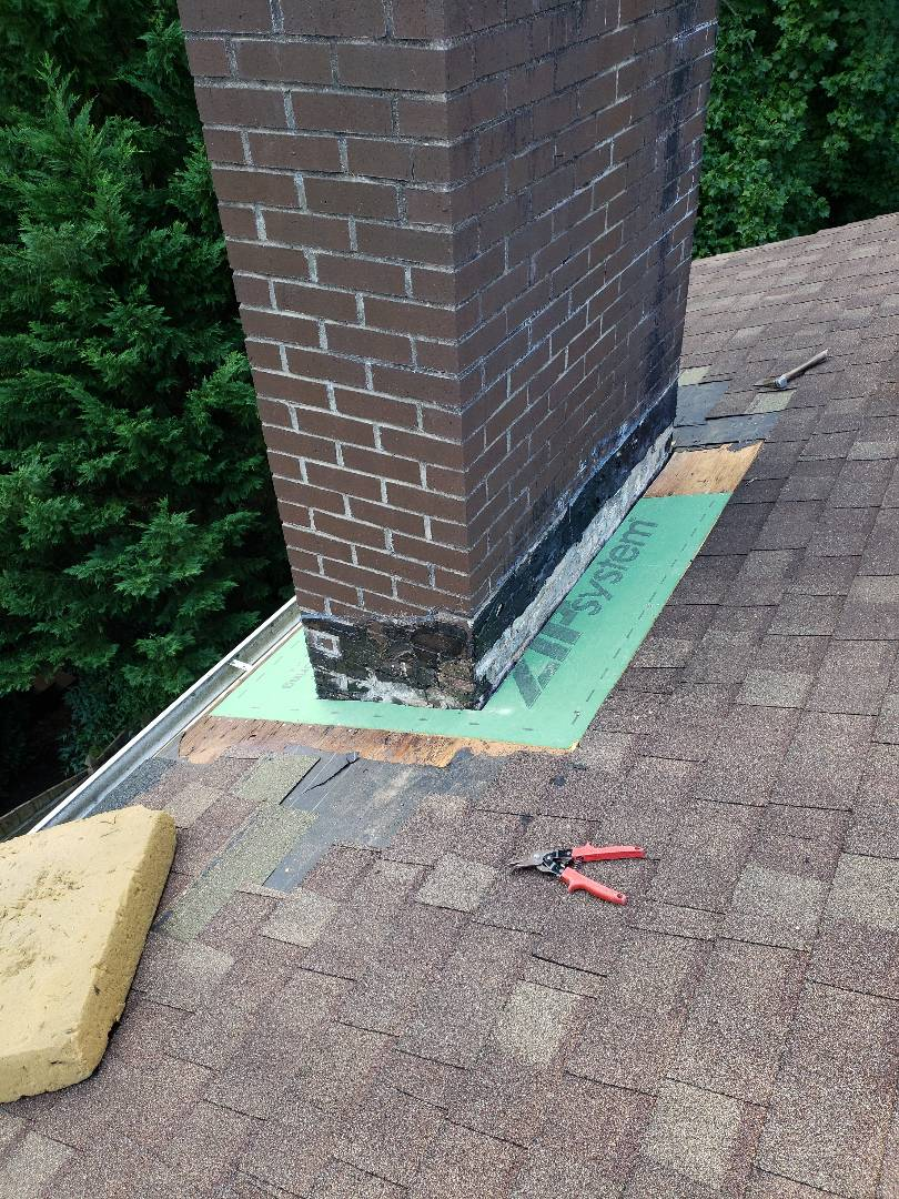 Knoxville, TN - We removed the damaged roofing materials to begin the repairs on this roof leak. We installed custom flashing, decking, GAF Storm Guard and Owens Corning Desert Tan shingles.