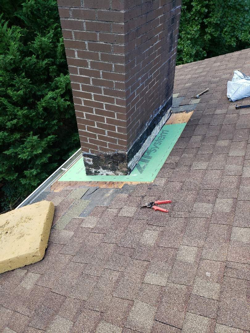 Knoxville, TN - Mobley Brothers Roofing and Renovation repaired a leak around a chimney. We installed new flashing, new decking, GAF Storm Guard and Owens Corning Desert Tan shingles. No more leaks on this very nice home in Knoxville.