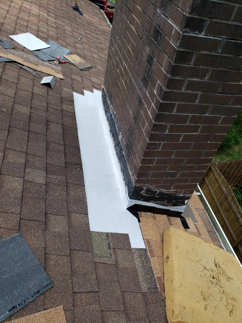 Knoxville, TN - Mobley Brothers Roofing and Renovation was called about a roof that had some significant leaks. We installed flashing, decking, GAF Storm Guard and Owens Corning Desert Tan shingles around the chimney to correct the problems with the leaking chimney.