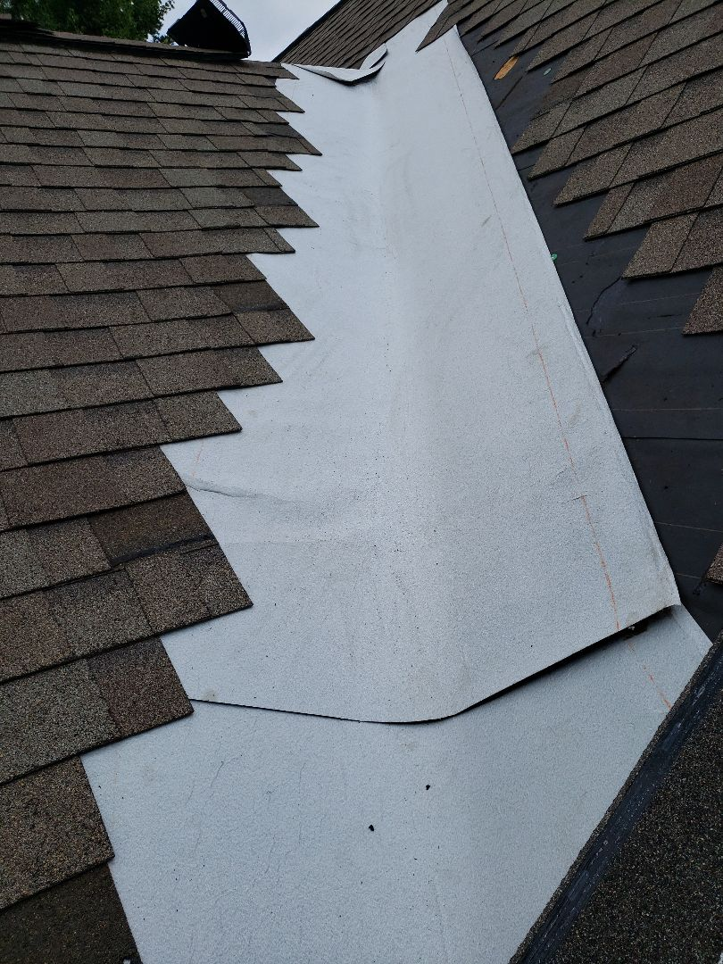 Knoxville, TN - Mobley Brothers Roofing and Renovation, repaired a leak in a valley of the roof and installed new shingles and GAF Storm Guard Leak Barrier.