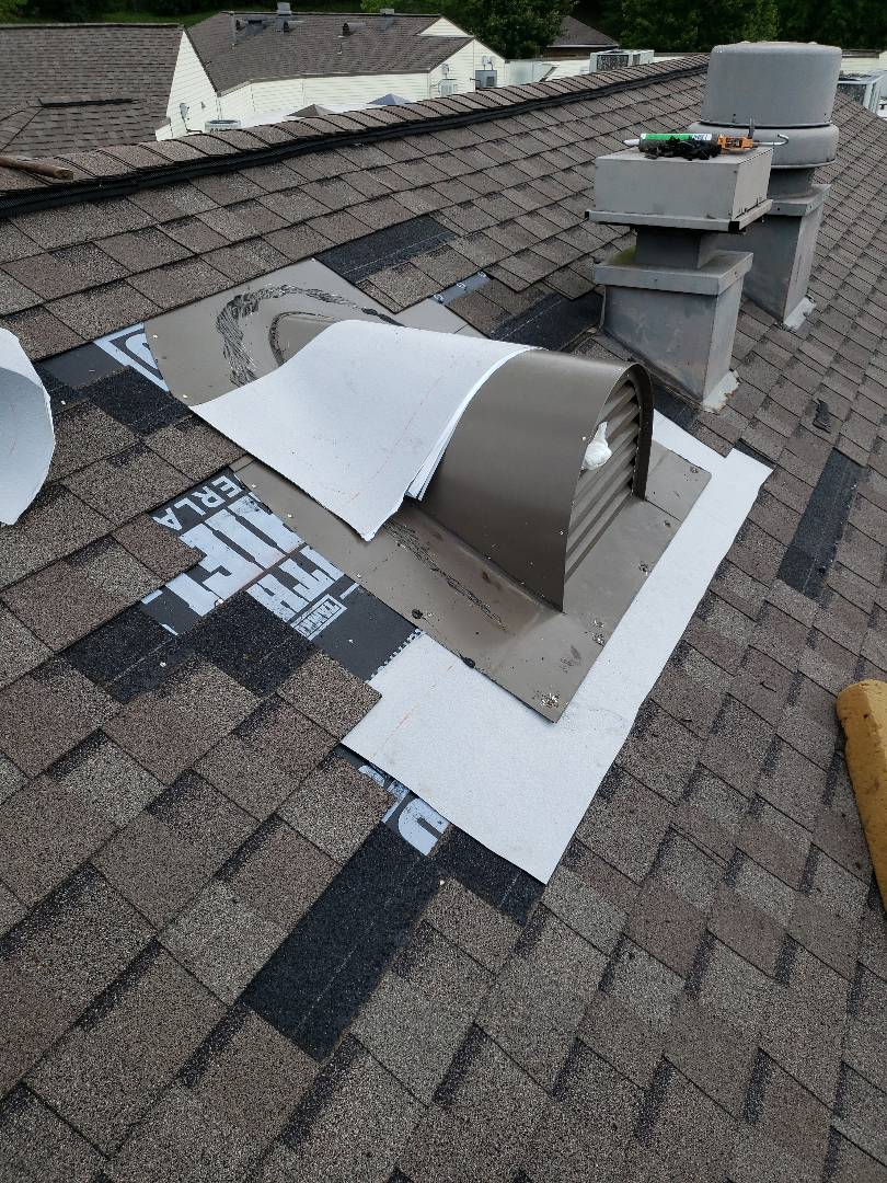 Knoxville, TN - A half round metal dormer vent was leaking and Mobley Brothers Roofing and Renovation repaired the leak. We removed the damaged shingles, resealed the dormer and installed GAF Storm Guard Leak Barrier and GAF Weatherwood Timberline shingles.