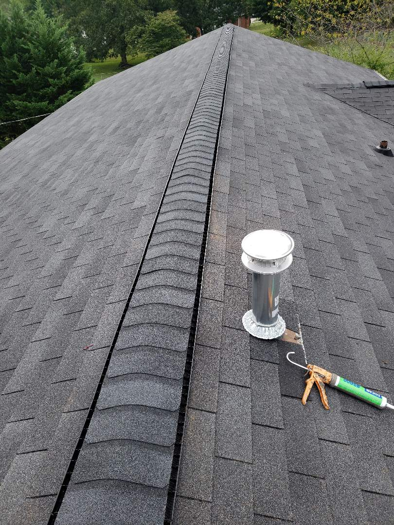 Maryville, TN - This quaint family home had storm damage to the roof and gutters. There was a gap between the roof and gutters caused by a tree falling against the home. We repaired the gutters, damaged shingles and a pipe vent. The flashing around the chimney also needed to be replaced.