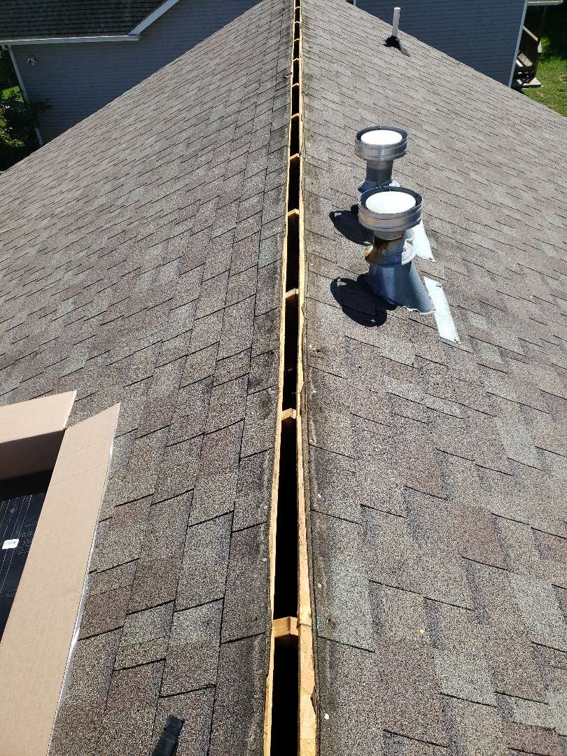 Powell, TN - We received a call about a home with a roof leak after a storm. One of our crews found that a ridge cap on this home was damaged and needed to be replaced. Mobley Brothers Roofing and Renovation removed the damaged roofing materials and installed a new ridge vent and shingles.