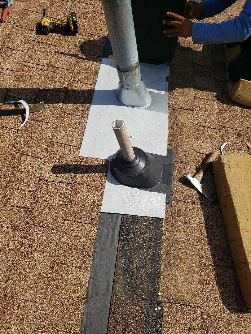 Knoxville, TN - An old and decaying pipe boot was one of the reasons this roof was leaking. Another roof vent also needed to be repaired. We removed the damaged roofing materials and repaired the vents. We installed GAF StormGuard vapor barrier and GAF Hickory shingles to complete the repair.