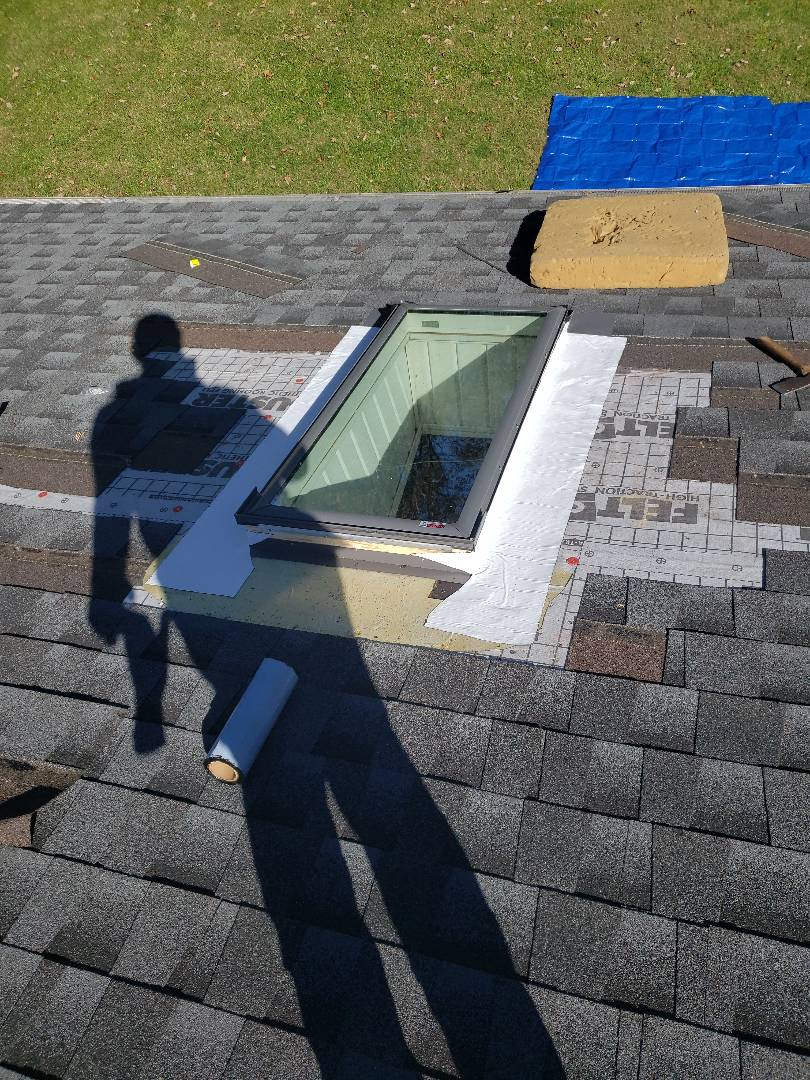 Clinton, TN -  We installed a new Velux skylight to replace an old leaking skylight. We matched the original shingles and installed GAF gray architectural shingles to replace the ones we had to remove.