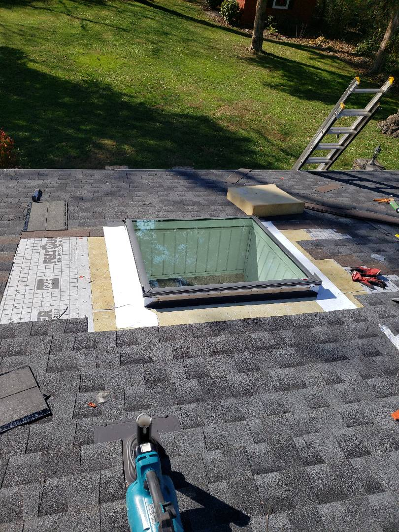 Clinton, TN - Mobley Brothers Roofing installed a Velux skylight in this home. We installed a charcoal GAF architectural shingle to complete the repair.