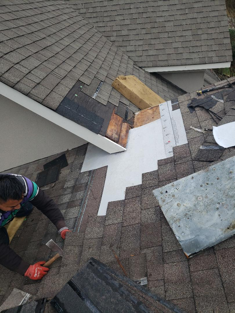 Knoxville, TN - One of our team removing shingles to complete a roof repair.