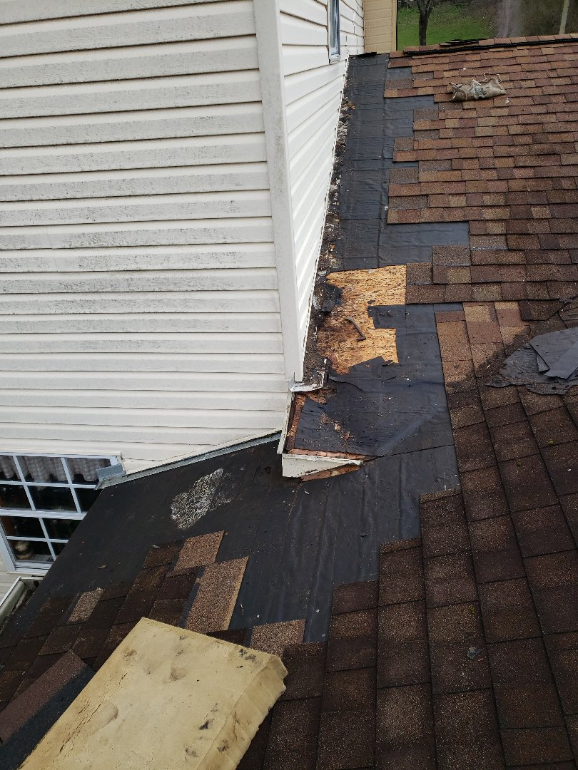Clinton, TN - Our team went out and looked at a roof and found a significant roof leak. We removed the damaged roof deck, and installed matching brown shingles and completed the roof repair.
