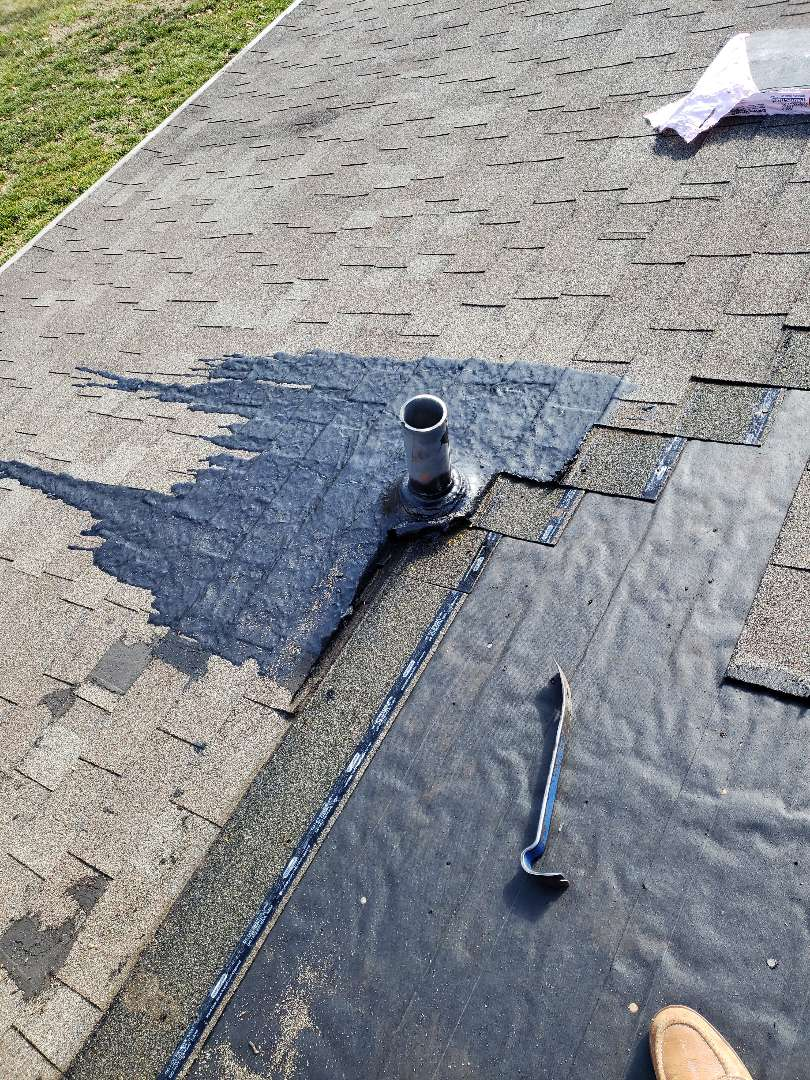 Lenoir City, TN - A homeowner had discovered a roof leak and decided to repair it with tar. This did not work and they called us. We removed the damaged shingles, the damaged pipe boot, installed a new pipe boot and a new matching shingles.