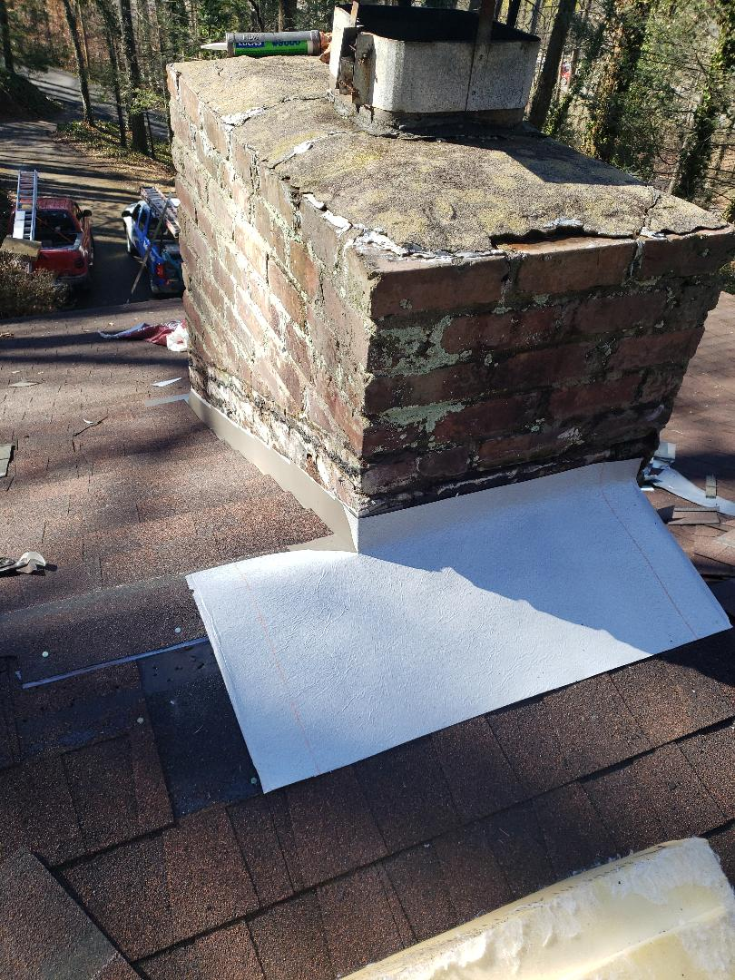 Knoxville, TN - Putting down vapor barrier and flashing on this roof repair.