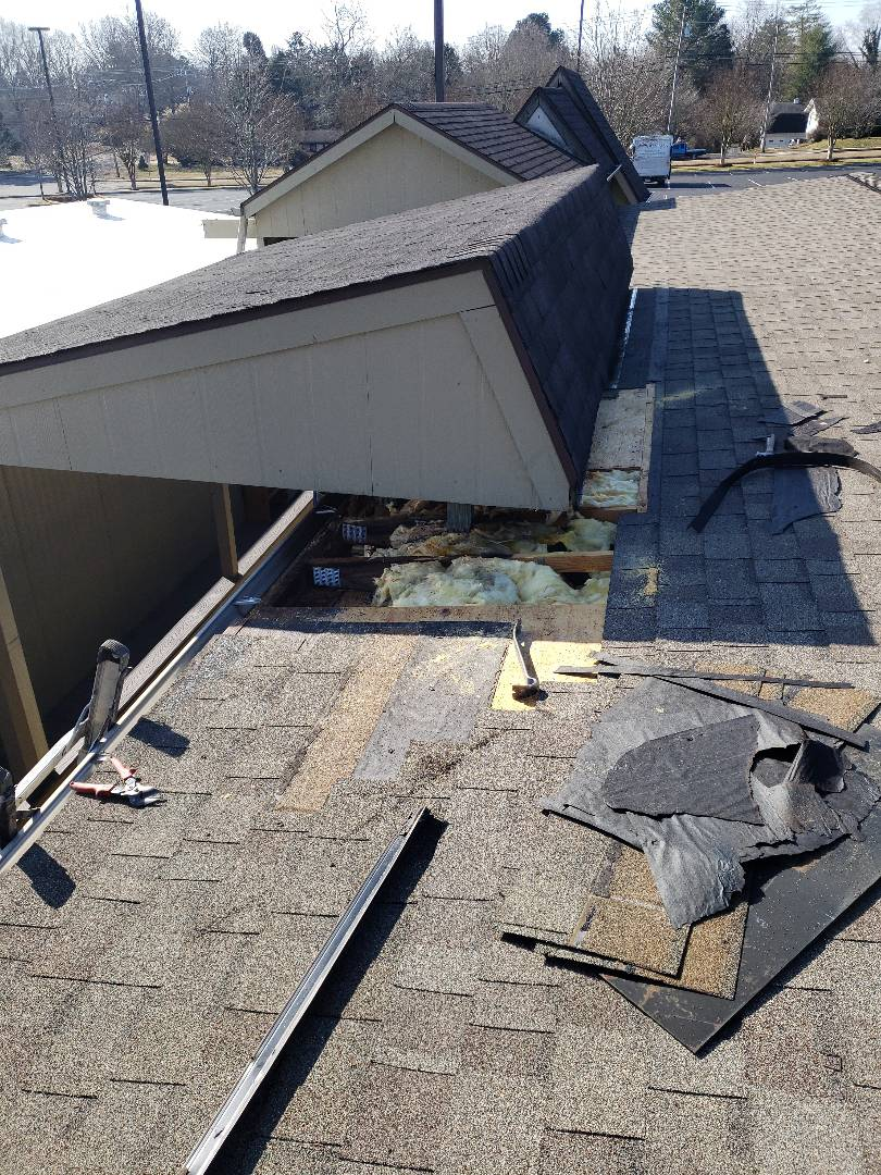 Knoxville, TN - We repaired a severe roof leak on this commercial building. We had to replace rotten wood, damaged shingles, fascia and flashing.