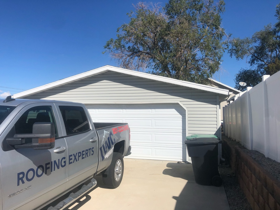 Salt Lake City, UT - Roofing bid on a detached garage. Taking old shingles off adding new shingles to the roof.