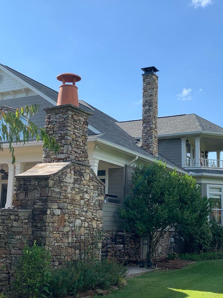 Guntersville, AL - Putting on chimney pots and custom covers