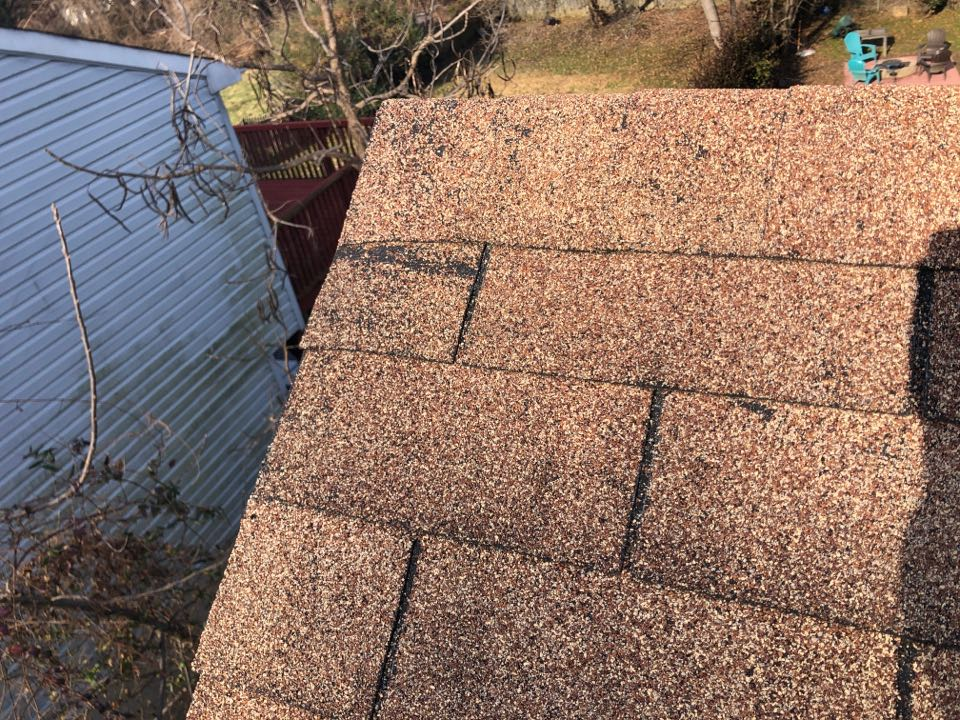 Capitol Heights, MD - Wind damage roof shingles.