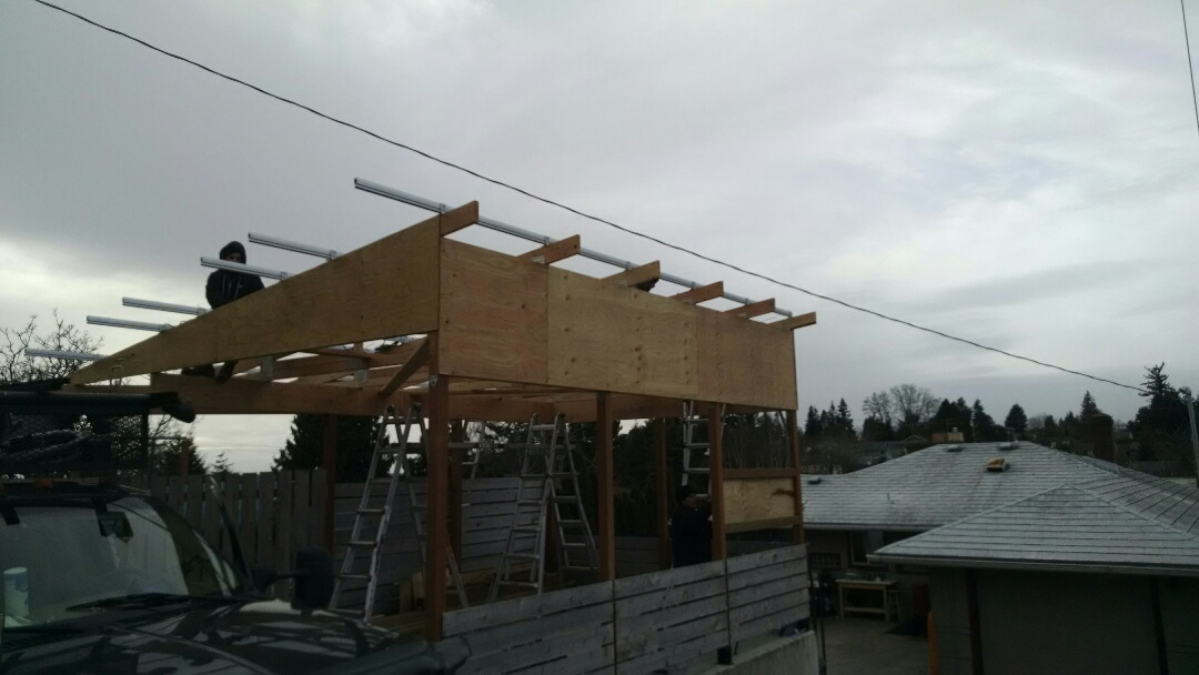 Seattle, WA - Putting the solar roof on a newly constructed carport.