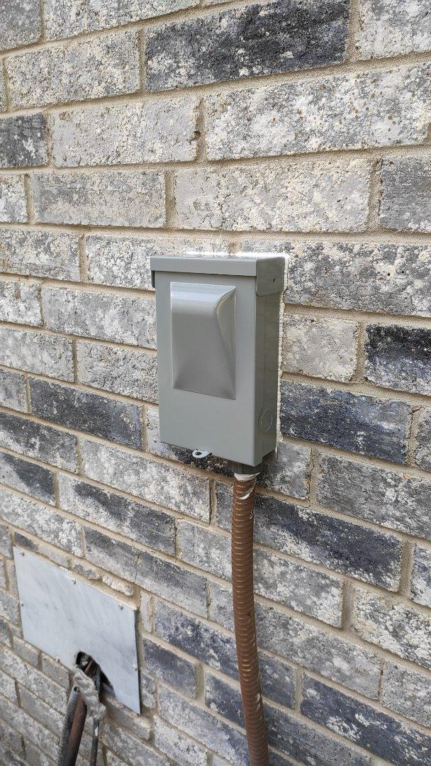 Garland, TX - Replaced a broken disconnect on an AC.