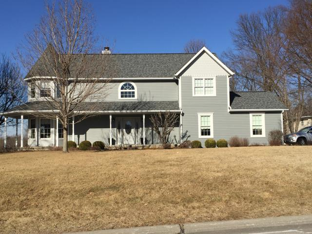 "Maryville, IL - They had storm damage to their roof and aluminum siding. We met with them after they had been turned off by many of the storm chasers working in the area. We met and presented a proposal to re-roof their home with a new Certainteed architectural roof system and replacing their aluminum siding with James Hardie. We utilized a 5"" reveal Gray Slate James Hardie lap siding and historic window trim surround utilizing Fypon headers and cellular PVC historic sill trim."