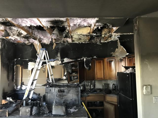 New River, AZ - Inspecting and estimating repairs for a single-family home in Anthem. Kitchen fire caused extensive damage to the entire home.
