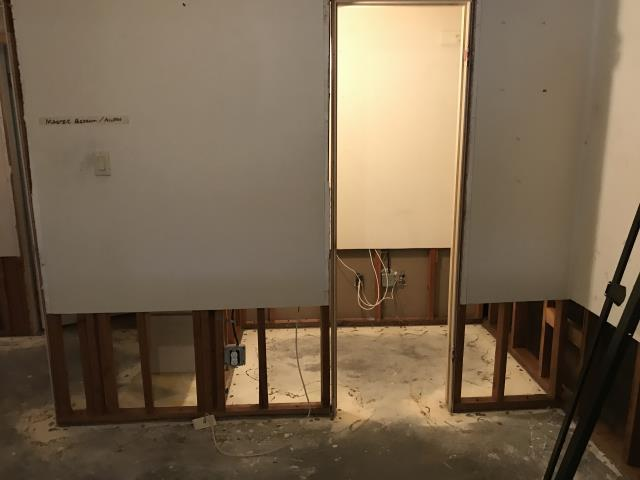 Glendale, AZ - Starting installation of new drywall for couple in Glendale after home flooded.