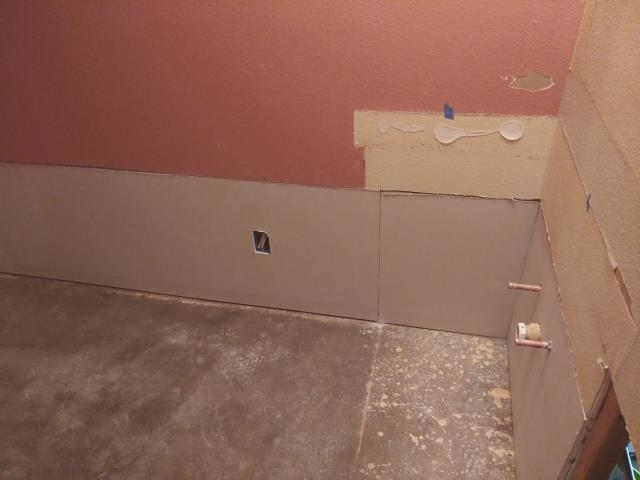 Glendale, AZ - Finishing installation of Drywall in hall bathroom for a couple in Glendale.