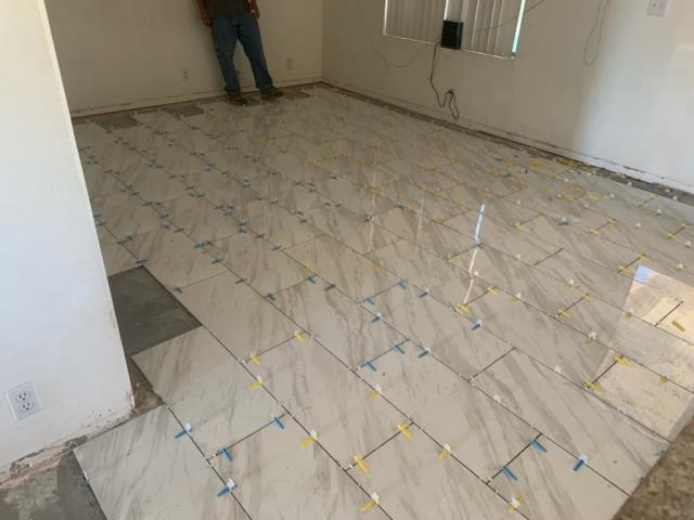 Glendale, AZ - Finishing installing a customers new tile floor after he had a loss due to mitigation.