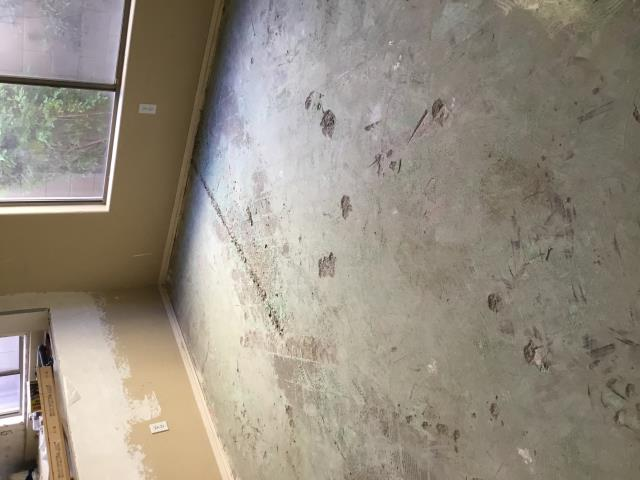 Cave Creek, AZ - Did a light cleaning to knock down some of the dust from demolition on glue down floor, before they start painting in this Cave Creek home.