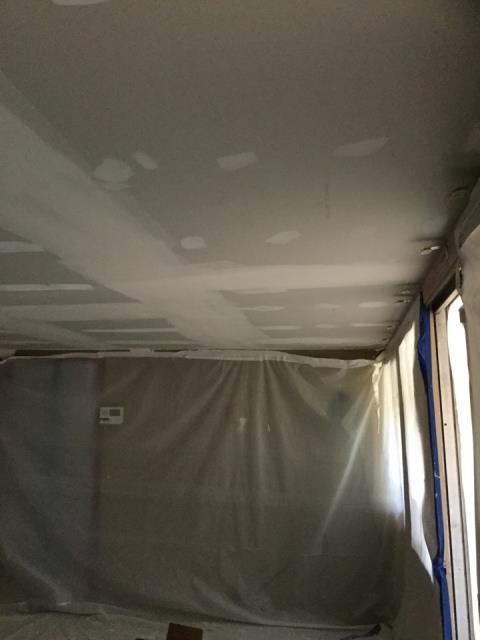 Phoenix, AZ - Working on members drywall repairs in his living room ceiling.