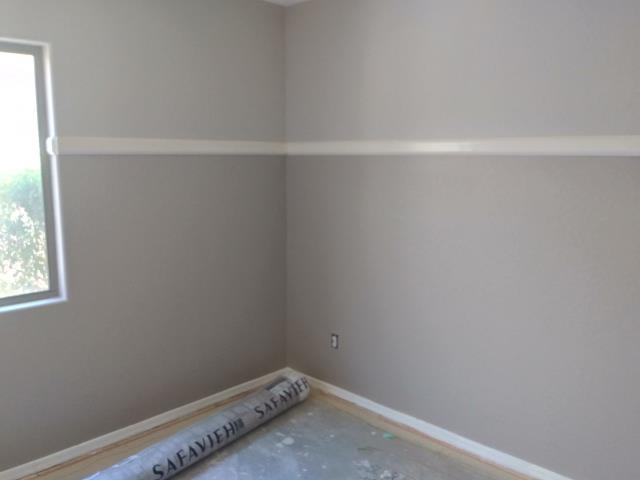 Cave Creek, AZ - Working on painting the interior of a family's home, after suffering from a water loss in Cave Creek.