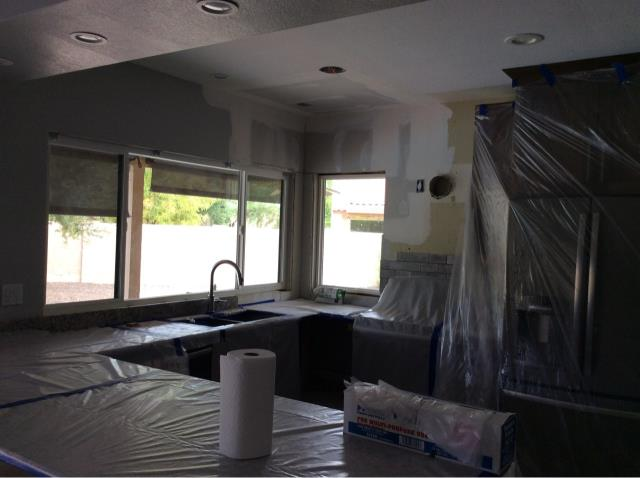 Chandler, AZ - Working on drywall repairs in a woman's home in Chandler, AZ.