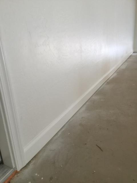 Goodyear, AZ - Began painting and caulking baseboard in the garage of a family in Goodyear after having a fire.