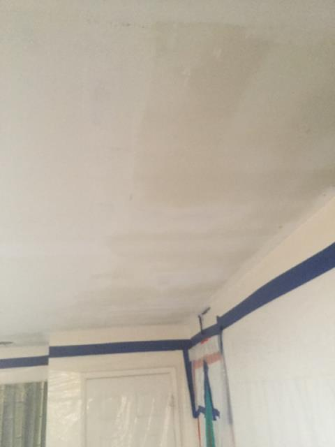 Phoenix, AZ - Working on drywall repairs on the ceiling in a family's home in Phoenix, AZ.