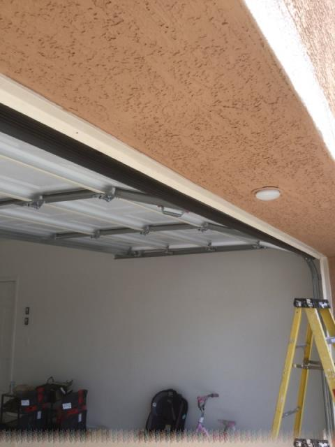 Goodyear, AZ - Finished caulking a family's new garage doors after going through a fire loss in Goodyear, AZ.