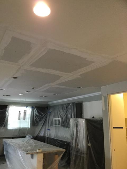Queen Creek, AZ - Working on installation of new ceiling drywall for a family in Queen Creek, after bathroom upstairs had water leak.