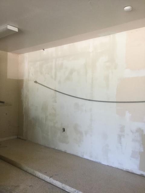 Phoenix, AZ - Working on Drywall repairs in this Phoenix home, after vehicle ran into Garage wall.