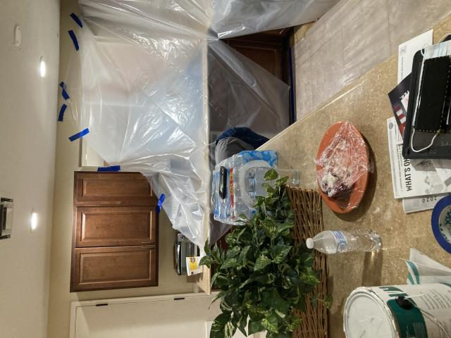 Mesa, AZ - Contents manipulation and putting plastic coverings to prepare for drywall repair and paint in this Mesa home.