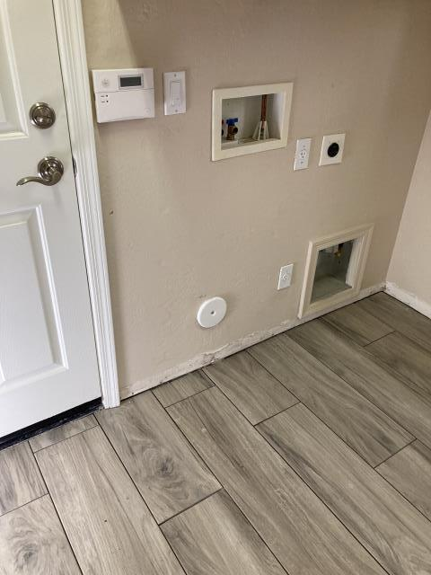 Doing a light clean after tile install.