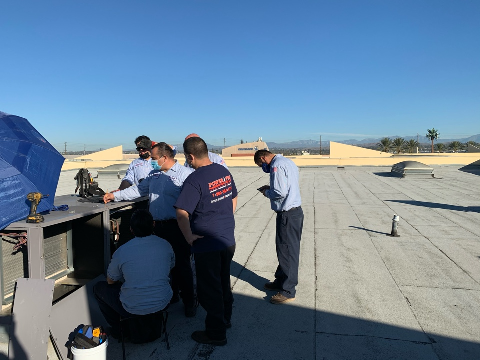 Cerritos, CA - Working on a rooftop unit A/C maintenance with my team.