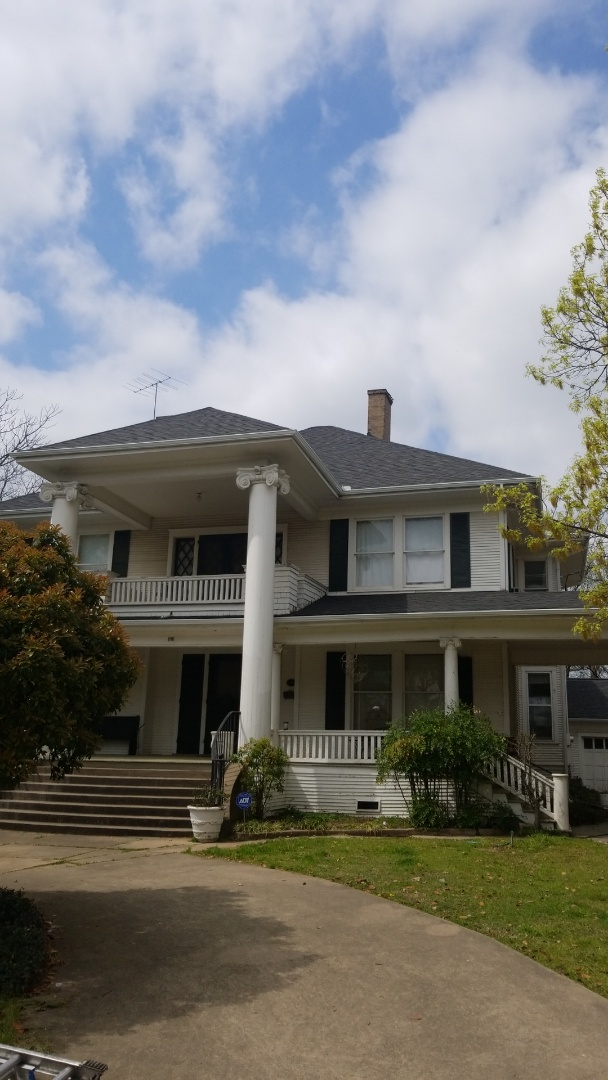 Sherman, TX - Lankford Roofing replaced roof with Owen's Corning Weatherguard Onyx black shingles and new white gutters.