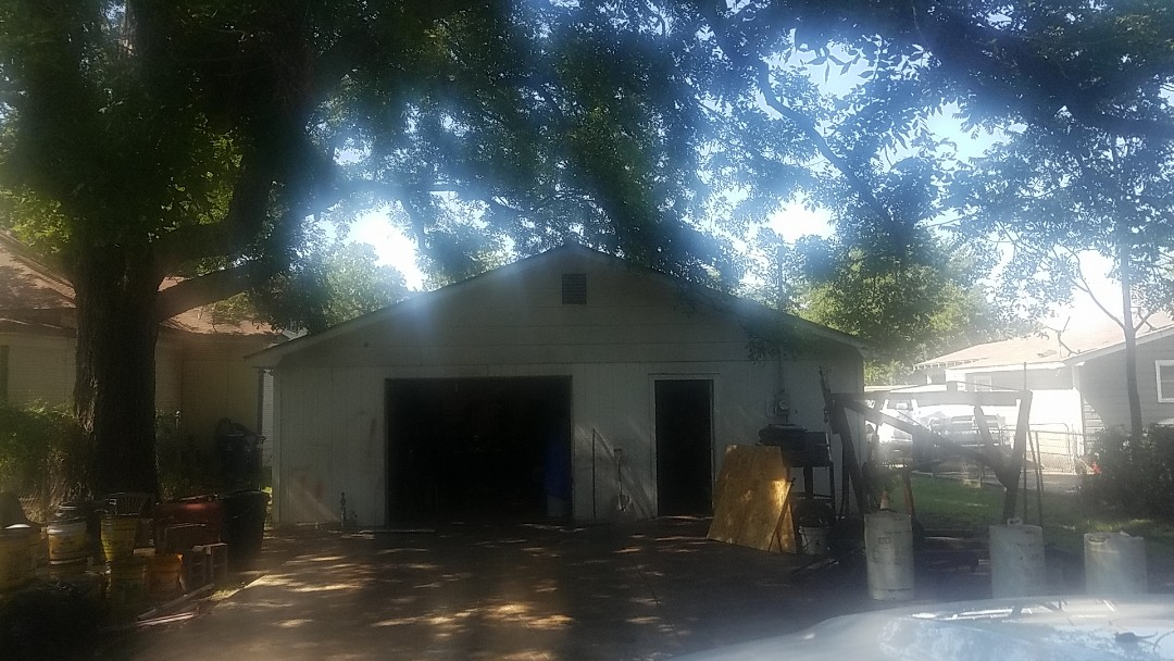 Denison, TX - Beautiful new Owens Corning Shasta white roof on a garage in Denison Texas by Lankford Roofing