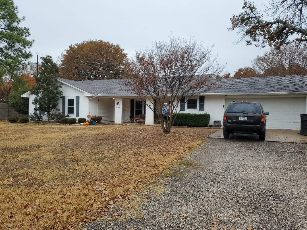 Pottsboro, TX - New white gutters on a stucco home on lake Texoma by Lankford Roofing