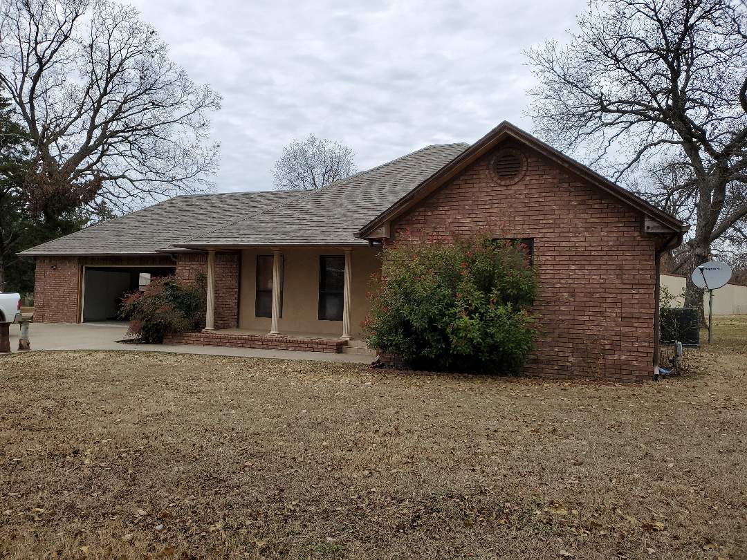 Kingston, OK - Backside of a beautiful new Owens Corning whether guard class 4 single driftwood color by Lankford reef in in Kingston Oklahoma by like lake texoma